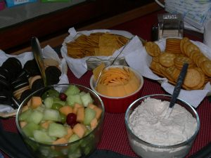 Assortment of fresh fruit, dip, cheese and crackers on a table