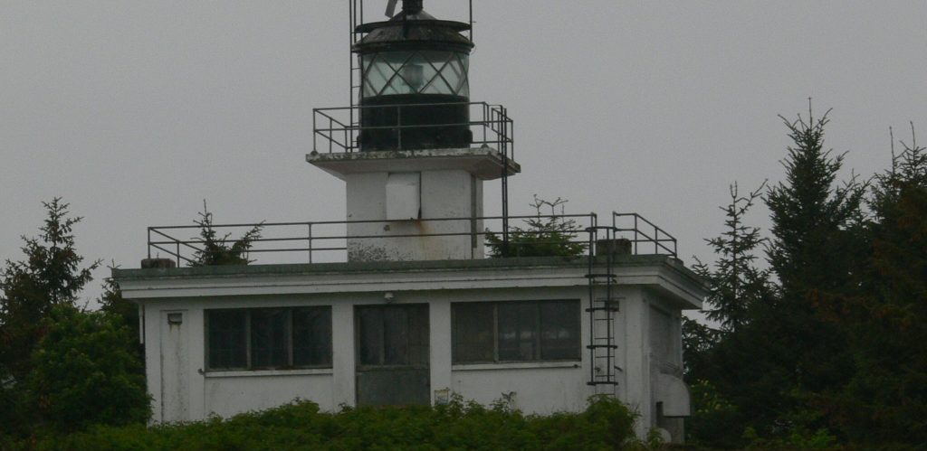 Ward Cove lighthouse with bald eagles perched on its rails
